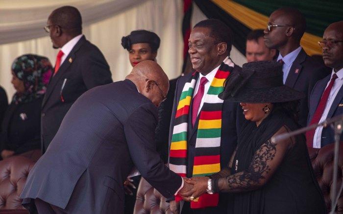 Former South African President Jacob Zuma greets Zimbabwean first lady Auxillia Mnangagwa.