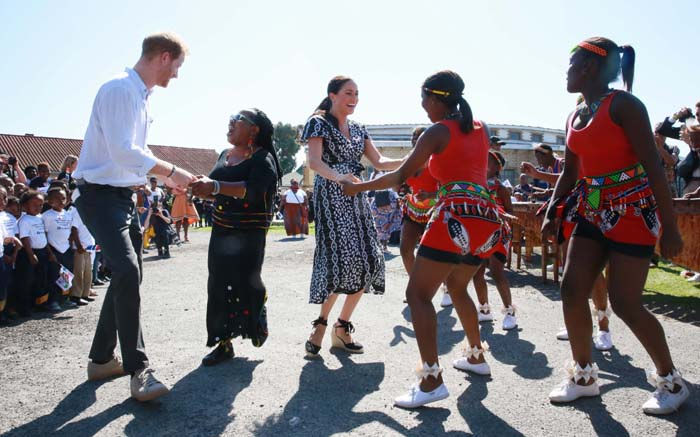 Duke and Duchess of Sussex, Prince Harry and Meghan Markle at the Trinity Society Church  in Nyanga, Cape Town on 23 September 2019. The sto