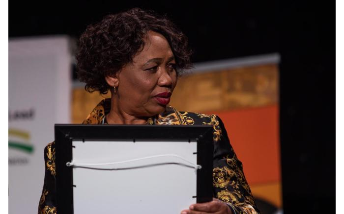 Basic Education Minister Angie Motshekga presents top learners with awards.