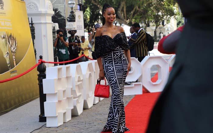 Actress Ntando Duma in a curve-hugging black and white dress. Kayleen Morgan/EWN