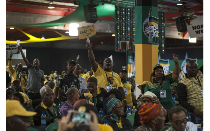 Disgruntled delegates raise their hands at Baleka Mbete at the ANC's national conference on 17 December 2017. Picture: Ihsaan Haffejee/EWN.