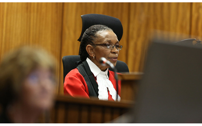 Judge Thokozile Masipa delivers judgment in the murder trial of paralympian Oscar Pistorius at the High Court in Pretoria on Friday, 12 September 2014. Picture: Pool.