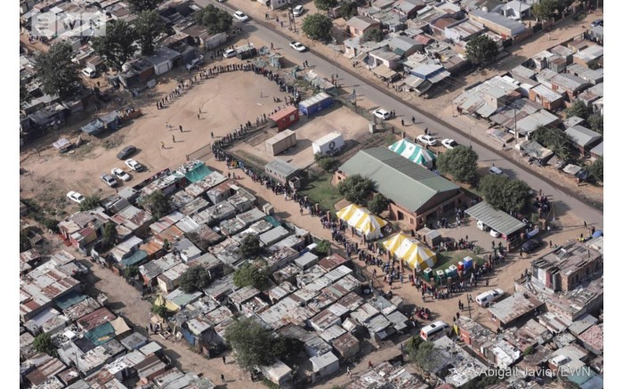 Voters stand in long queues as they patiently wait to cast their votes in Diepsloot, north of Johannesburg.