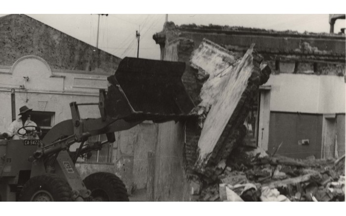 A bulldozer breaks down a house in District Six. Picture: The District Six Museum