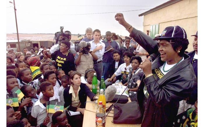 Winnie Madikizela-Mandela greets a crowd in the Olievenhoutbosch, Pretoria.