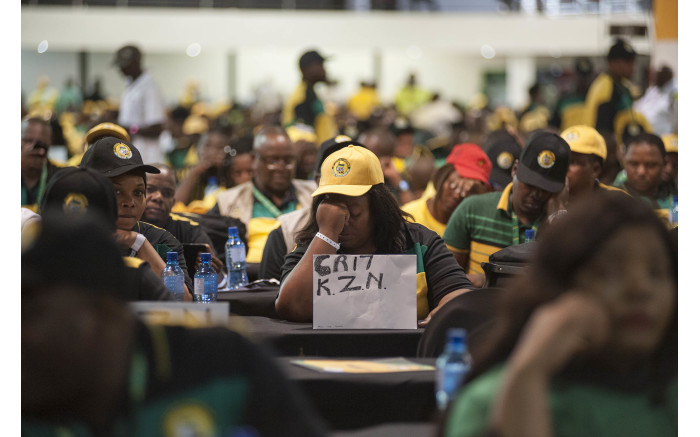 A delegate from KwaZulu-Natal displaying a sign showing support for Cyril Ramaphosa at the start of the ANC's national conference on 16 Dece