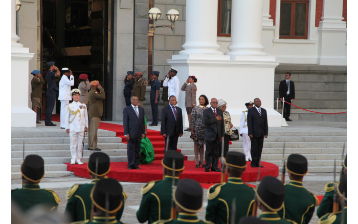 President Jacob Zuma stands for the national anthem.