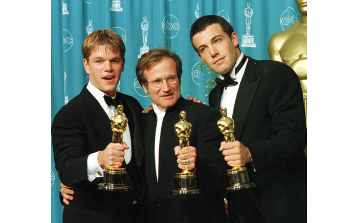 """Actors-writers Matt Damon (L) and Ben Affleck (R) pose with actor Robin Williams with their Oscars they won for """"Good Will Hunting"""" at the 70th Annual Academy Awards 23 March in Los Angeles. Damon and Affleck won Best Original Screenplay and Williams won for Best Supporting Actor. Picture: AFP."""