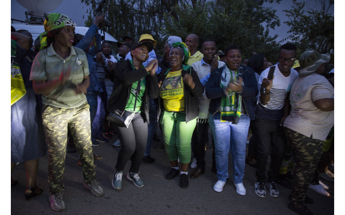 People can be seen gathering outside the home of the late anti-apartheid activist Winnie Madikizela-Mandela in Soweto.