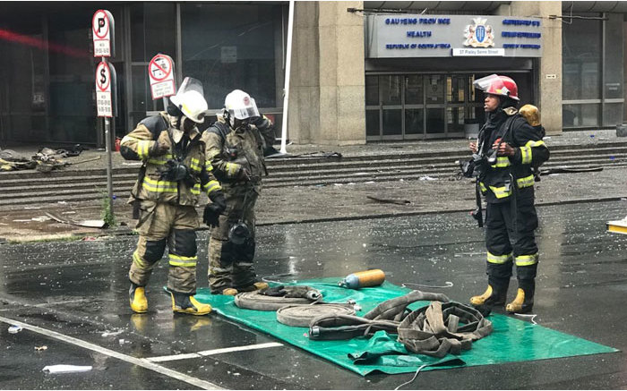 Firefighters clearing equipment on 7 September 2018 near the Lisbon Building following the deadly fire. Picture: Christa Eybers/EWN