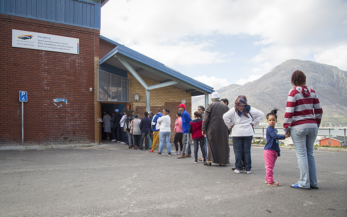 Voters queue outside the Hangberg sports centre in Hout Bay, Cape Town, on 3 August 2016. Picture: Aletta Harrison/EWN.