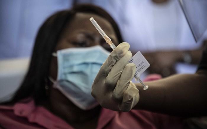 Gauteng Health MEC Nomathemba Mokgethi inspects the vaccine.  Picture: Abigail Javier/Eyewitness News