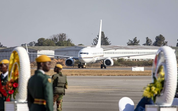 The plane carrying members of Robert Mugabe's family and his body arrives at the Robert Mugabe International Airport.