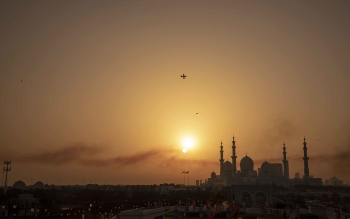 Jets fly over the Sheikh Zayed Mosque at sunset in display for the Special Olympics. Picture: Thomas Holder/EWN