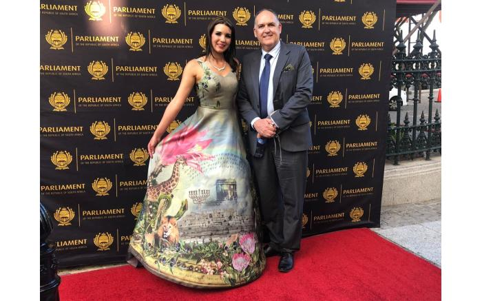 ACDP MP Steve Swart and his daughter Siobhan Swart in a brightly patterned dress.