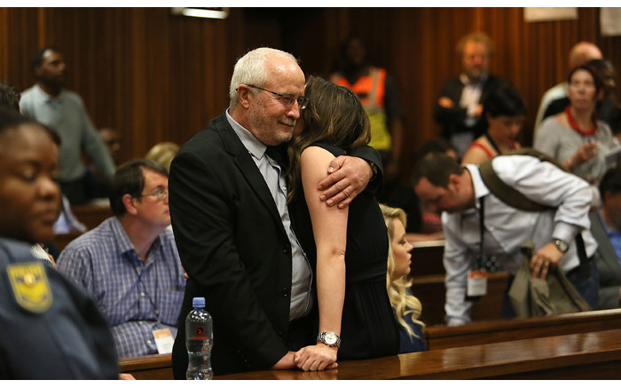 Henke, father of Oscar Pistorius, hugs Aimee Pistorius during a break in proceedings in the judgment in his murder trial at the High Court in Pretoria on Friday, 12 September 2014. Picture: Pool.