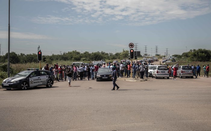 A wide shot view of the protesters blocking the road near the RTMC offices. Picture: Abigail Javier/EWN