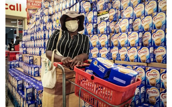 Shopper buys about 10 boxes of Cremora at Shoprite Diepsloot on Black Friday.