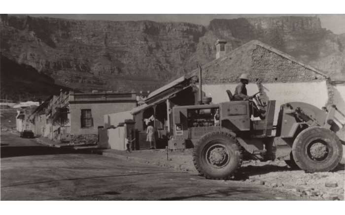 A bulldozer demolishes a house in District Six as residents are forced to the Cape Flats. Picture: The District Six Museum