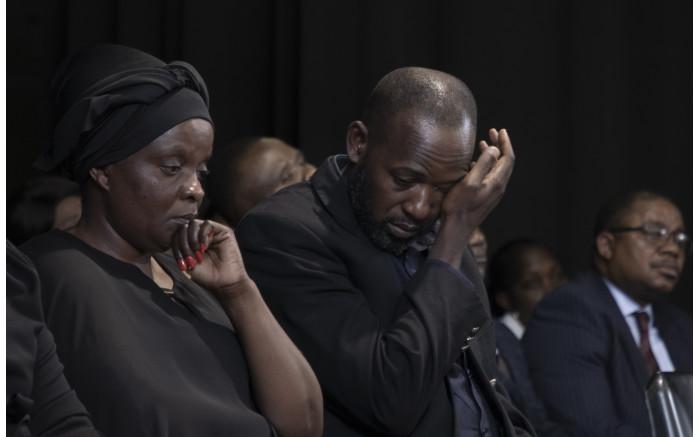 Anto Mpianzi and Ekila Guy Intamba, the parents of Enock Mpianzi, struggled to hold back their tears. Xanderleigh Dookey/EWN