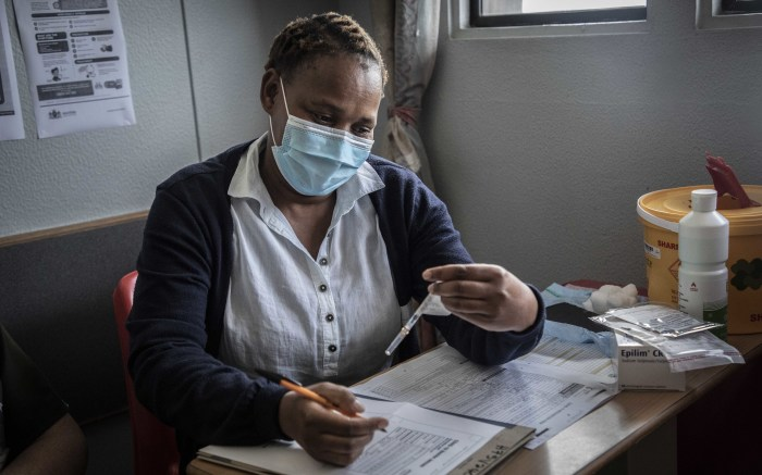 A vaccinator taking vaccine details ahead of vaccination at Steve Biko Hospital. Picture: Abigail Javier/EWN