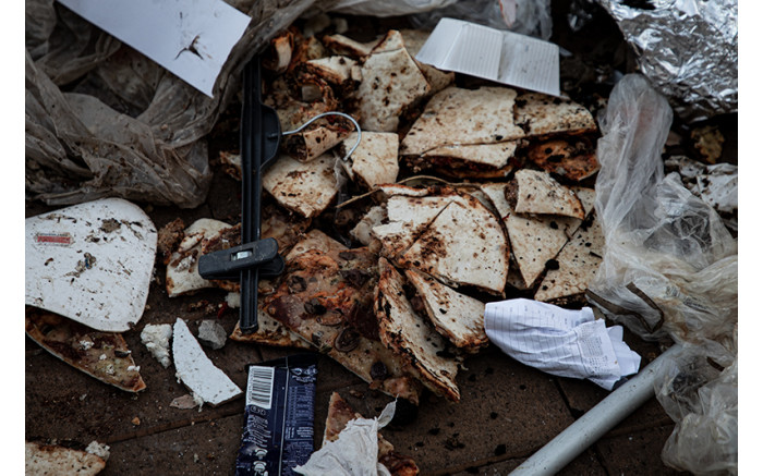 Discarded pizza slices in the rubble. Picture: Xanderleigh Dookey Makhaza/Eyewitness News