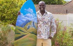 Car guard-turned-artist tranforms surfboard into work of art for a good cause