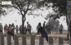 Rabie Ridge residents fight off 'land grabbers' occupying land