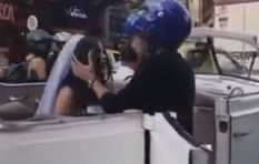 [WATCH] Biker pulls up beside ex's wedding car, begs her not to get married