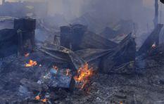 eNkanini residents rebuild shacks destroyed by fire