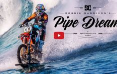 Watch this (mad!) man surf a giant wave on his motorcycle