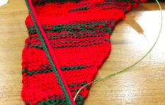 Mayor's knitting shows men talking too much in city council, stitch by stitch