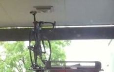 [WATCH] Driver crushes his bike on roof rack at McDonald's drive through...Ouch!