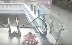 [WATCH] Horrific moment as baby falls down escalator at a mall...but is saved