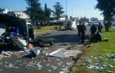 [WATCH] Money explodes into street after cash in transit heist shoot-out