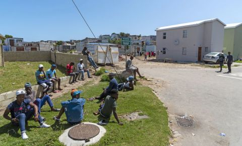 unemployment men on side of road Zwelihle, Hermanus, Western Cape 123rf