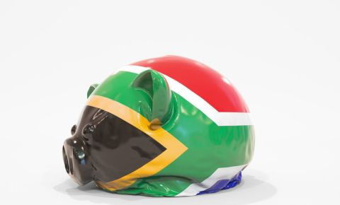 Deflating piggy bank with flag of South Africa. National financial crisis 123rf