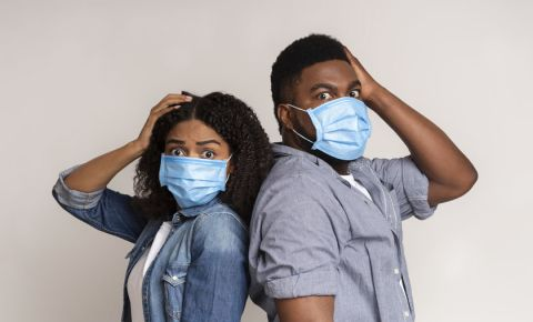 Woman and man wearing surgical masks 123rf 123rflifestyle covid-19 coronavirus