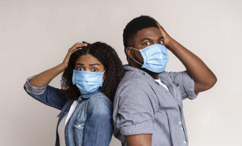 Woman and man wearing surgical masks 123rf 123rflifestyle covid-19 coronavirus