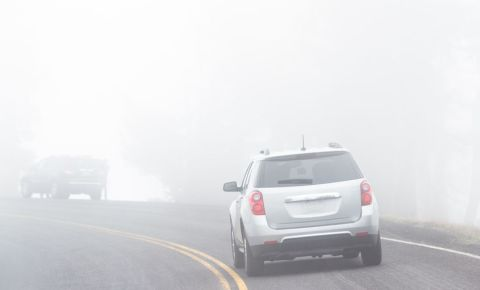 Cars driving in foggy weather low visibility driving safety 123rf