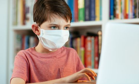 Boy child surgical mask computer homeschooling covid-19 coronavirus 123rf