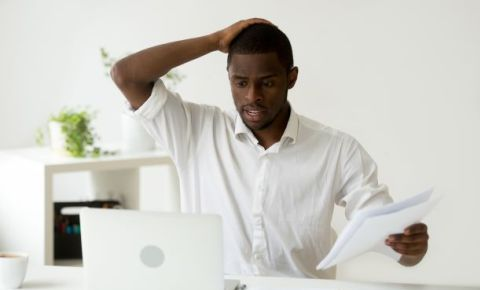 stress-black-man-papers-laptop-work-tax-fees-money-finance-woes-businessjpg123rf