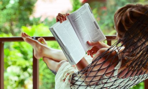 Young woman reading relaxing on hammock holidays 123rflifestyle 123rf
