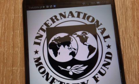 International Monetary Fund logo displayed on smartphone IMF 123rfeconomy 123rf