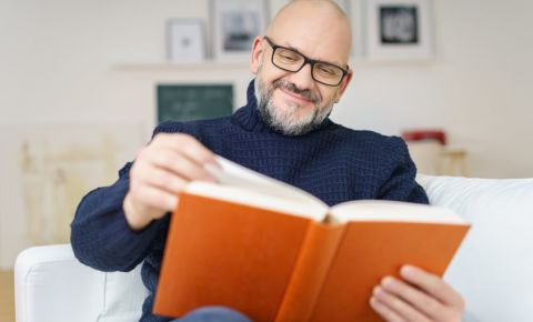 middle-aged-white-man-reading-book-knowledge-education-novel-literature-123rf