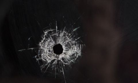 Bullet hole in glass crime 123rfcrime 123rf