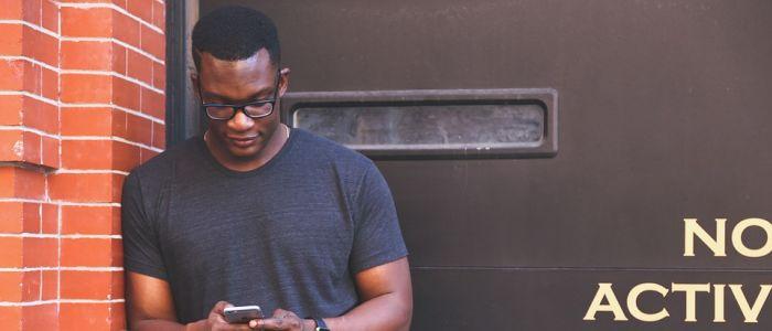 black-man-identity-cellphone-fitnessjpg